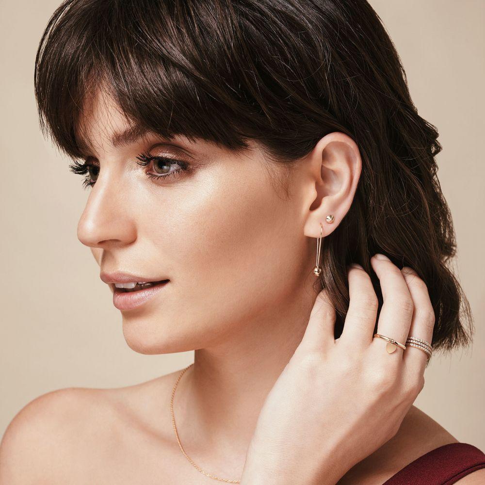 תכשיטי זהב לנשים   עגילים צמודים מזהב לבן 14 קראט - ניטים זהב