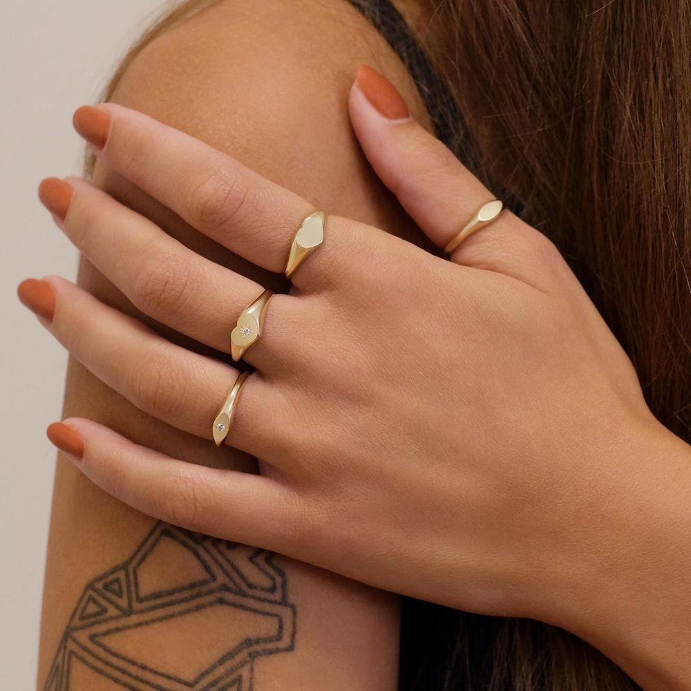 תכשיטי זהב לנשים | טבעת מזהב צהוב 14 קראט - חותם אליפסה מנצנץ